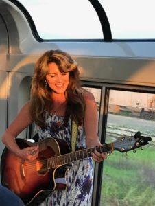 Gigi Love playing on Train